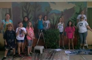 Girl Scounts with mural